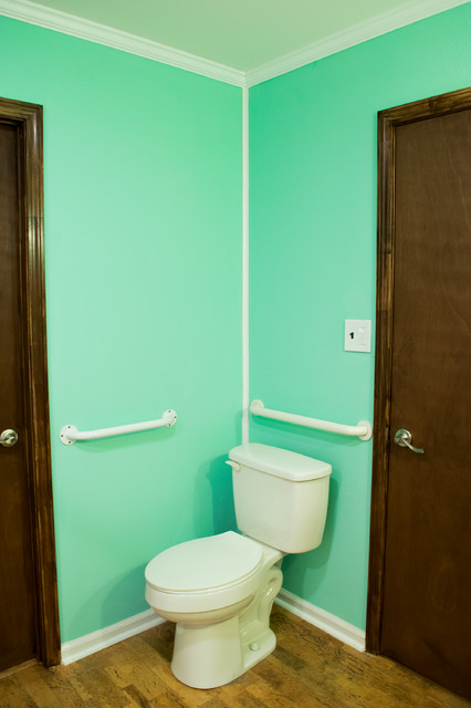 Example of a mid-sized classic 3/4 brown floor bathroom design in New Orleans with medium tone wood cabinets, a two-piece toilet, blue walls and an undermount sink