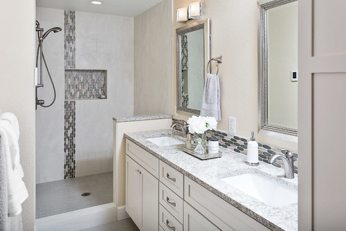 White painted bathroom vanity in a trendy bathroom.