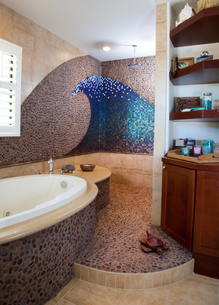 Example of a large beach style master mosaic tile and blue tile pebble tile floor and gray floor bathroom design in San Diego with recessed-panel cabinets, dark wood cabinets, multicolored walls and solid surface countertops