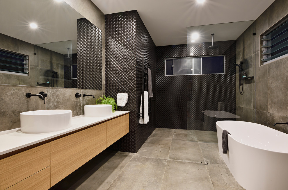 Example of a mid-sized trendy 3/4 black tile cement tile floor and gray floor bathroom design in Sunshine Coast with brown cabinets and a vessel sink