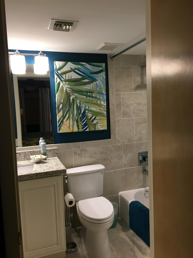Bathroom - mid-sized tropical 3/4 blue tile and mosaic tile cement tile floor and beige floor bathroom idea in Boston with raised-panel cabinets, white cabinets, a two-piece toilet, blue walls, an undermount sink, granite countertops and white countertops