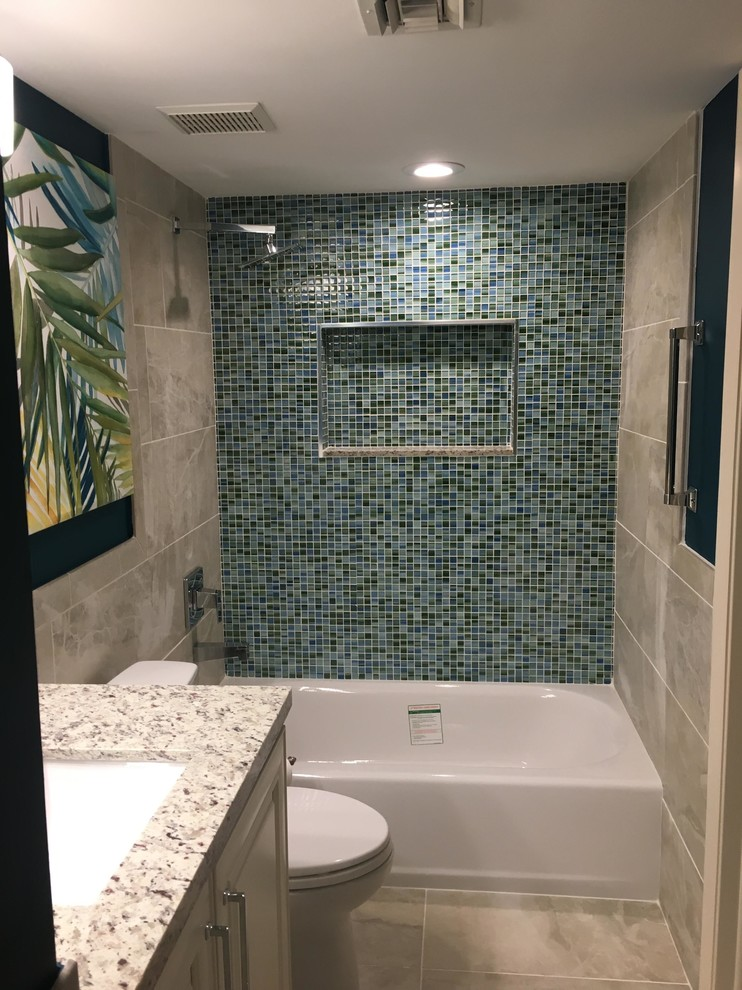 Mid-sized island style 3/4 blue tile and mosaic tile cement tile floor and beige floor bathroom photo in Boston with raised-panel cabinets, white cabinets, a two-piece toilet, an undermount sink, granite countertops and white countertops