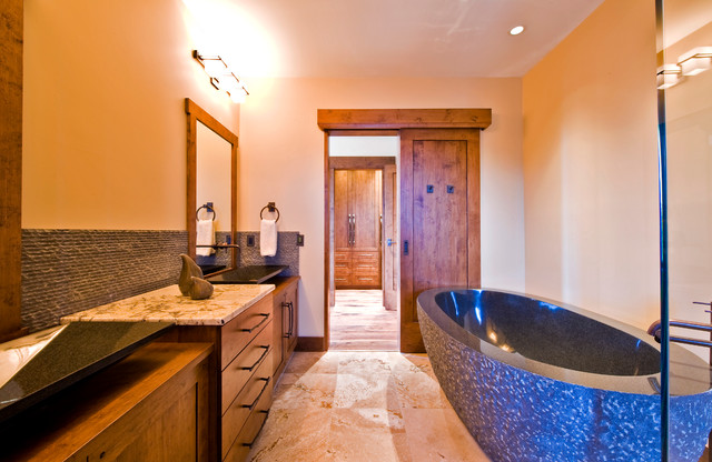 Rustic Bathroom by Sticks and Stones Design Group Inc