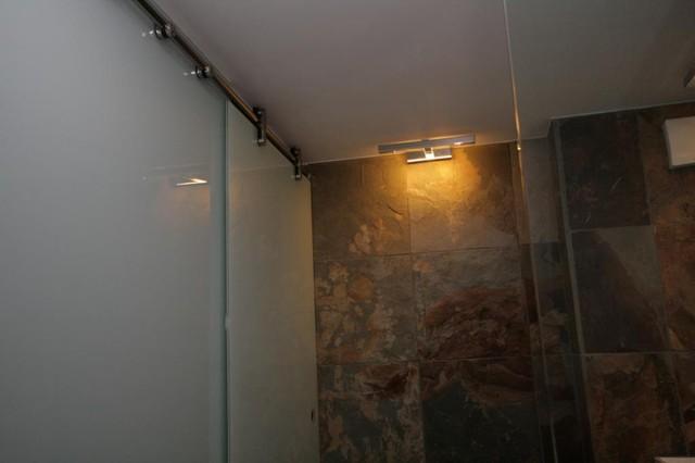 Old school building conversion contemporary bathroom for Bathroom builders east london
