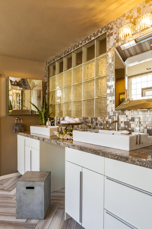 Inspiration for a mid-sized modern master multicolored tile and glass tile porcelain tile and brown floor bathroom remodel in Phoenix with flat-panel cabinets, white cabinets, gray walls, a vessel sin
