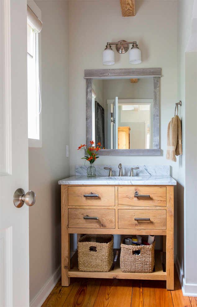 Inspiration for a beach style bathroom remodel in San Francisco with medium tone wood cabinets and flat-panel cabinets