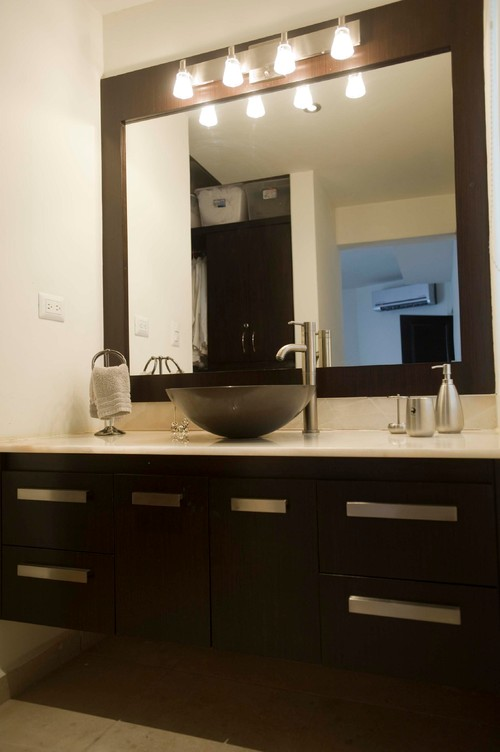 vanity with lights on mirror.  Vanity mirror and light fixture