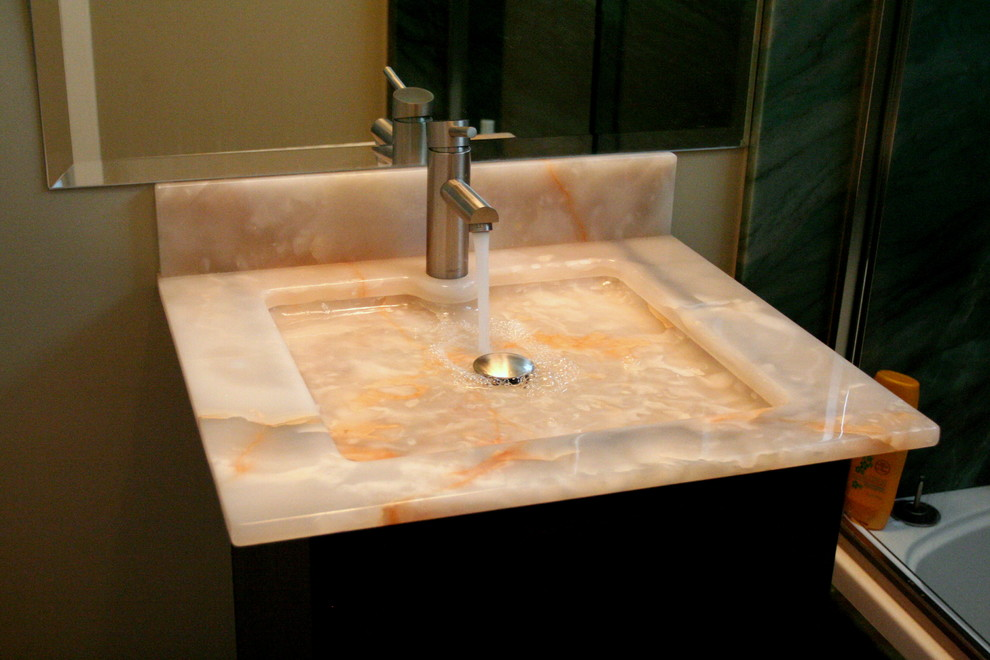 Example of a small trendy 3/4 limestone floor bathroom design in Los Angeles with an integrated sink, flat-panel cabinets, dark wood cabinets and beige walls