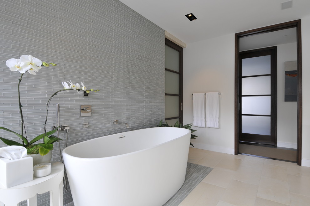 Inspiration for a modern master blue tile freestanding bathtub remodel in New York with white walls, an integrated sink and flat-panel cabinets