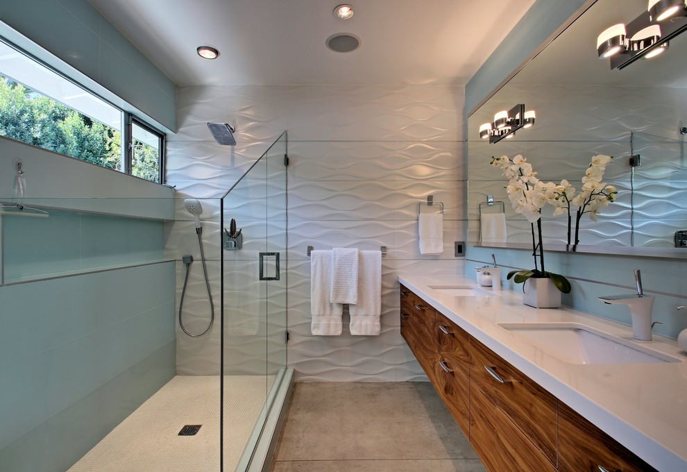 Inspiration for a mid-sized 1960s concrete floor corner shower remodel in Los Angeles with an undermount sink, flat-panel cabinets and medium tone wood cabinets