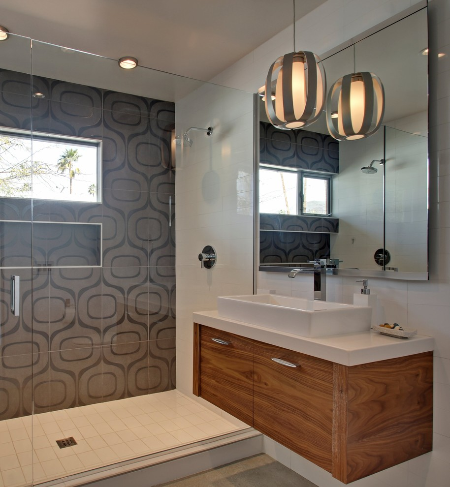 Mid-sized 1950s alcove shower photo in Los Angeles with flat-panel cabinets, medium tone wood cabinets and white walls