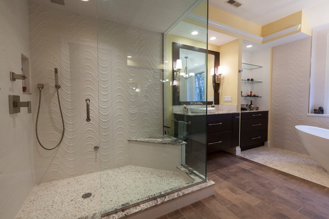 Example of a large trendy master beige tile and porcelain tile porcelain floor bathroom design in Bridgeport with a vessel sink, flat-panel cabinets, dark wood cabinets, onyx countertops, a two-piece toilet and yellow walls