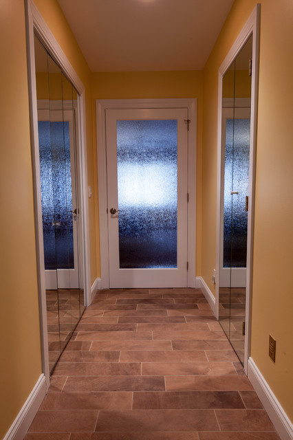 Bathroom - large contemporary master beige tile and porcelain tile porcelain floor bathroom idea in Bridgeport with a vessel sink, flat-panel cabinets, dark wood cabinets, onyx countertops, a two-piece toilet and yellow walls
