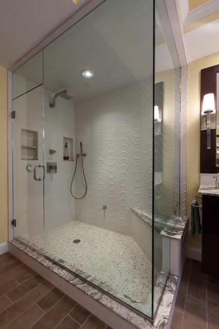 Large trendy master beige tile and porcelain tile porcelain floor bathroom photo in Bridgeport with a vessel sink, flat-panel cabinets, dark wood cabinets, onyx countertops, a two-piece toilet and yellow walls