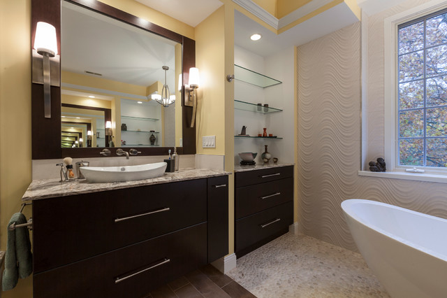 Inspiration for a large contemporary master beige tile and porcelain tile porcelain floor bathroom remodel in Bridgeport with a vessel sink, flat-panel cabinets, dark wood cabinets, onyx countertops, a two-piece toilet and yellow walls