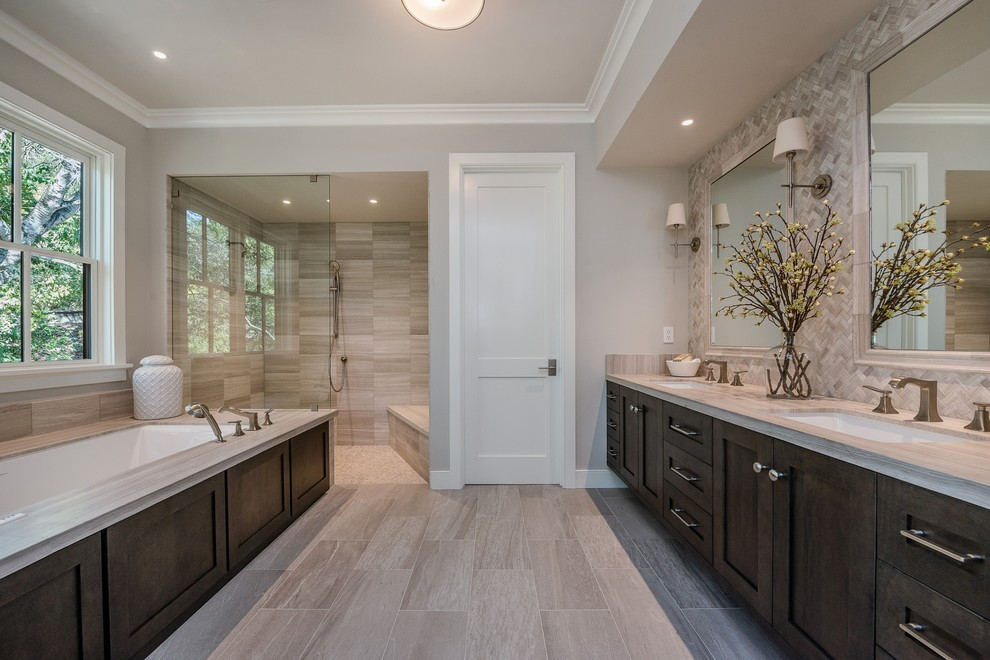 Example of a large cottage master gray tile and ceramic tile gray floor and porcelain tile bathroom design in San Francisco with shaker cabinets, dark wood cabinets, an undermount tub, gray walls, an undermount sink, a one-piece toilet and quartz countertops