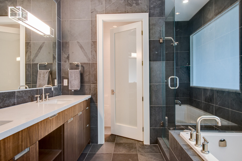 Inspiration for a transitional gray tile corner shower remodel in Vancouver with flat-panel cabinets and dark wood cabinets