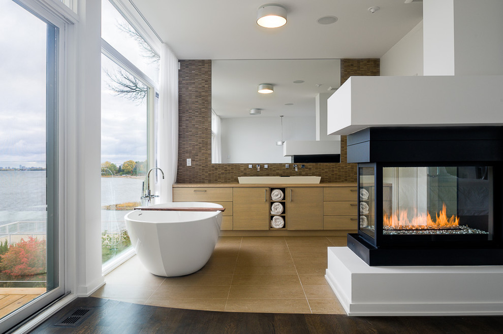 Inspiration for a contemporary freestanding bathtub remodel in Ottawa with a vessel sink