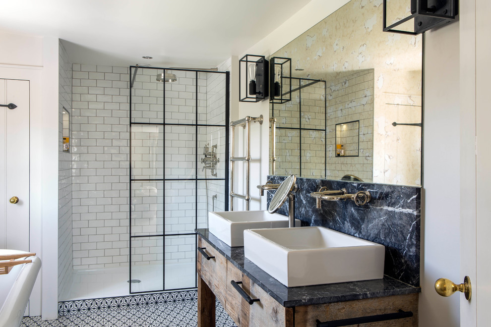 This is an example of a medium sized contemporary bathroom in Oxfordshire with flat-panel cabinets, light wood cabinets, a walk-in shower, white walls, a vessel sink, marble worktops, multi-coloured floors, an open shower and black worktops.