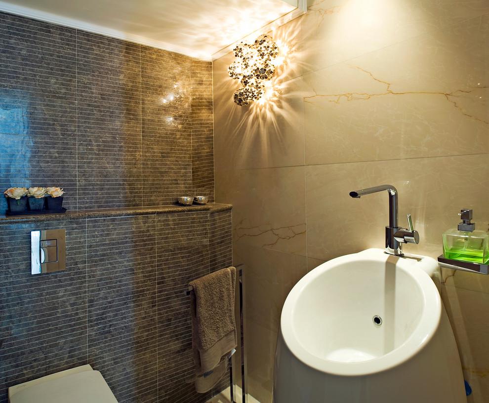 Trendy brown tile bathroom photo in Tel Aviv with a pedestal sink