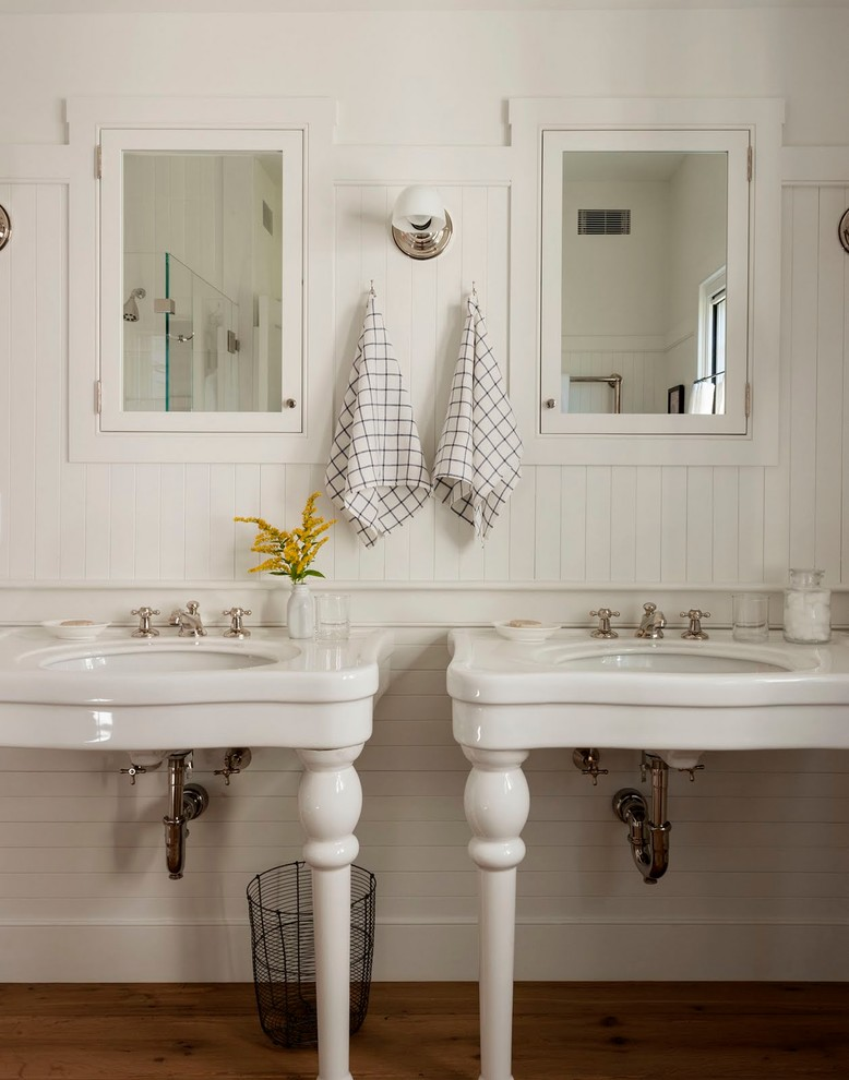 Inspiration for a country dark wood floor bathroom remodel in Boston with white walls and an undermount sink