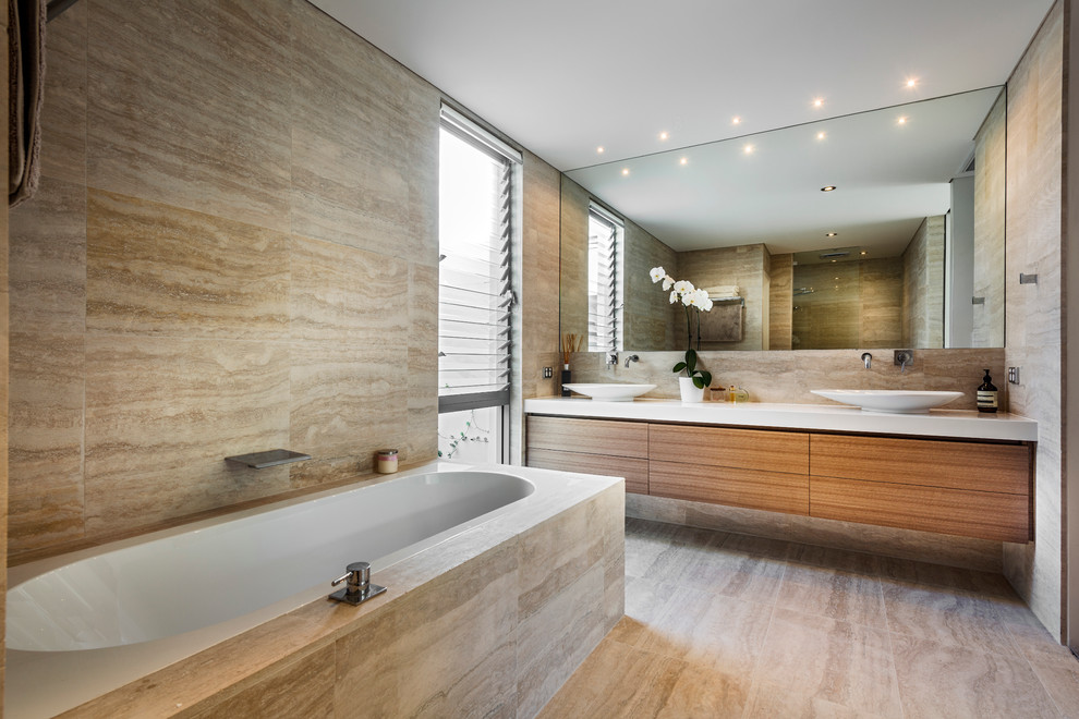 Inspiration for a contemporary travertine tile bathroom remodel in Perth with a vessel sink