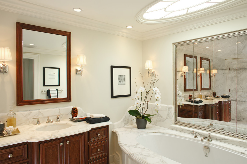 Large trendy master multicolored tile and marble tile bathroom photo in San Francisco with an undermount sink, raised-panel cabinets, dark wood cabinets, an undermount tub, white walls and marble countertops