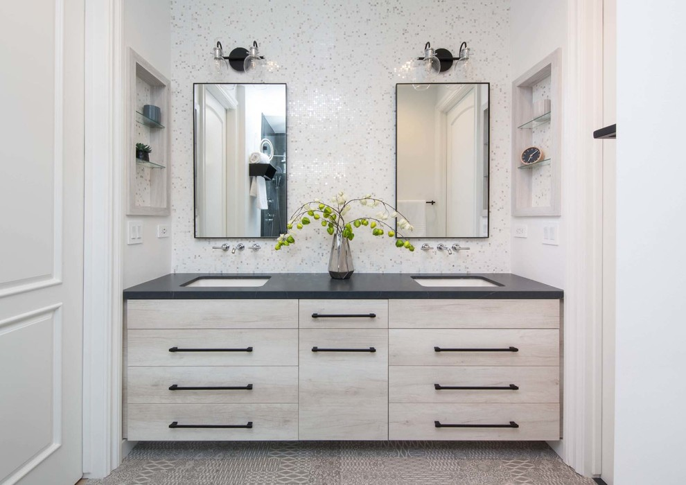 Bathroom - contemporary white tile and mosaic tile gray floor bathroom idea in Los Angeles with flat-panel cabinets, light wood cabinets, white walls, an undermount sink and black countertops