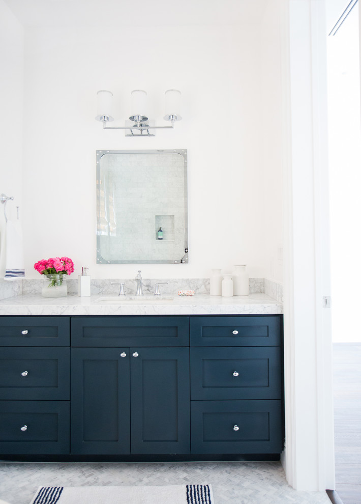Large transitional bathroom photo in Los Angeles with blue cabinets, marble countertops, white walls, an undermount sink and shaker cabinets