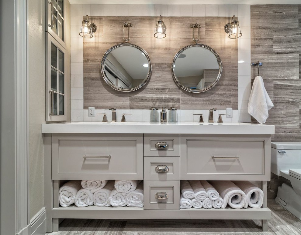 Inspiration for a mid-sized transitional master brown tile and porcelain tile porcelain floor and brown floor bathroom remodel in Boston with recessed-panel cabinets, gray cabinets, brown walls, an undermount sink and solid surface countertops