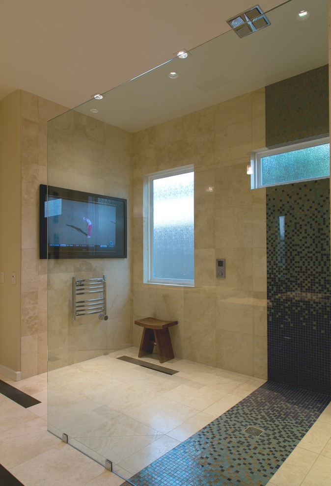 Example of a mid-sized trendy master mosaic tile travertine floor bathroom design in Other with beige walls