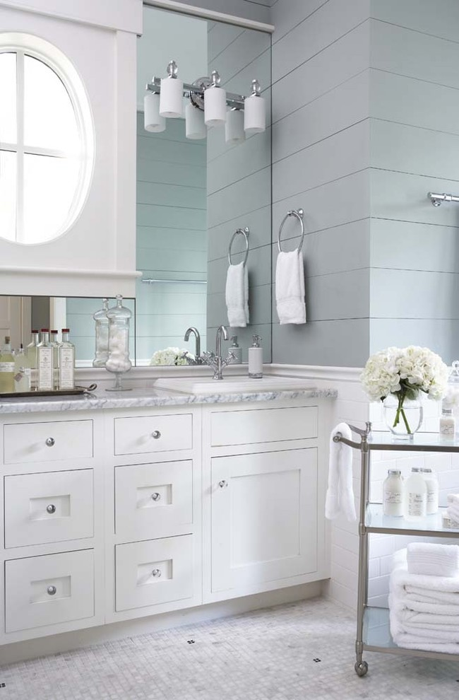Inspiration for a large timeless master white tile and subway tile mosaic tile floor bathroom remodel in Charleston with shaker cabinets, white cabinets, marble countertops, blue walls and a drop-in sink