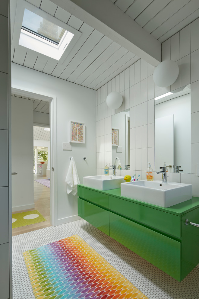 Inspiration for a mid-century modern kids' white tile bathroom remodel in San Francisco with a vessel sink and green cabinets
