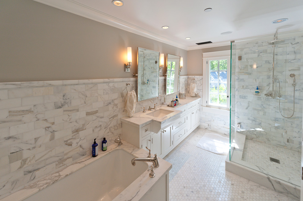 Large transitional master gray tile, white tile and marble tile marble floor and white floor corner shower photo in San Francisco with shaker cabinets, white cabinets, an undermount tub, beige walls, an undermount sink, marble countertops and a hinged shower door