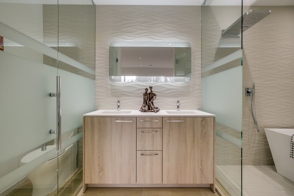 Inspiration for a mid-sized contemporary master beige tile and porcelain tile bathroom remodel in Seattle with an undermount sink, flat-panel cabinets, light wood cabinets, a two-piece toilet, white walls and solid surface countertops