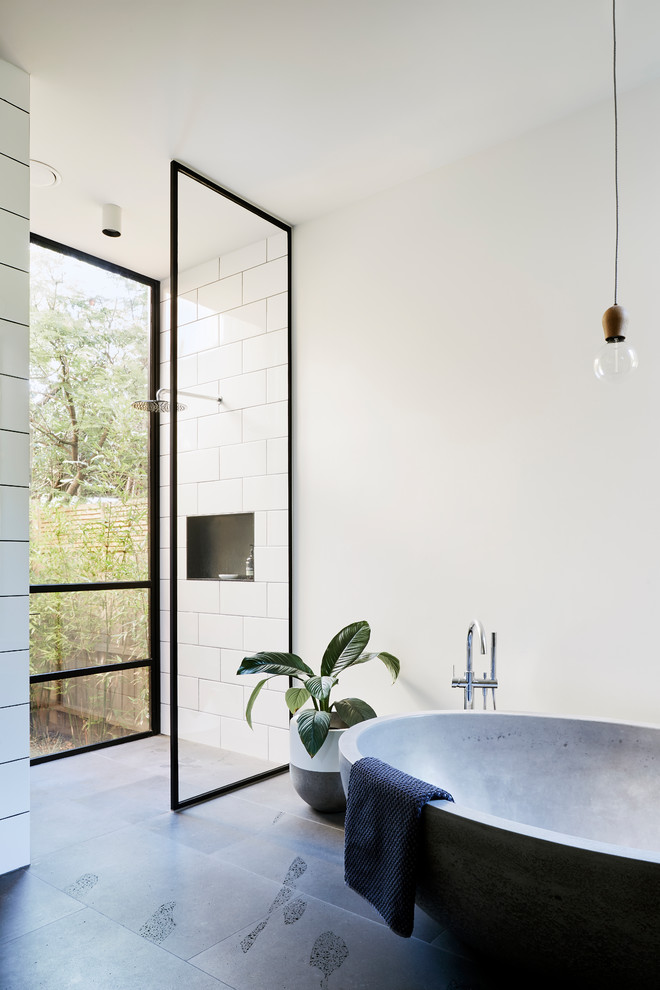 Bathroom - industrial master white tile bathroom idea in Melbourne with white walls