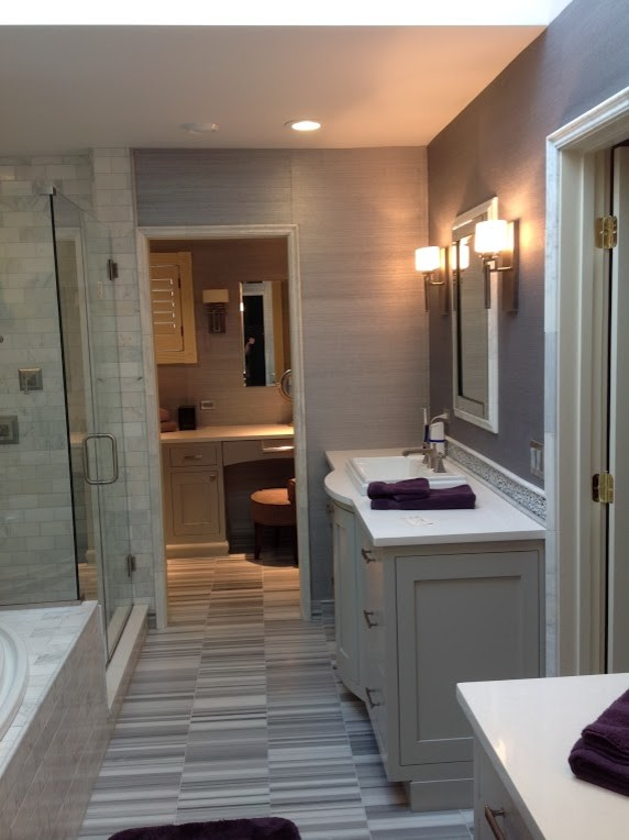 Large trendy master gray tile and porcelain tile porcelain tile and gray floor bathroom photo in Chicago with furniture-like cabinets, gray cabinets, gray walls, a drop-in sink, quartz countertops and a hinged shower door