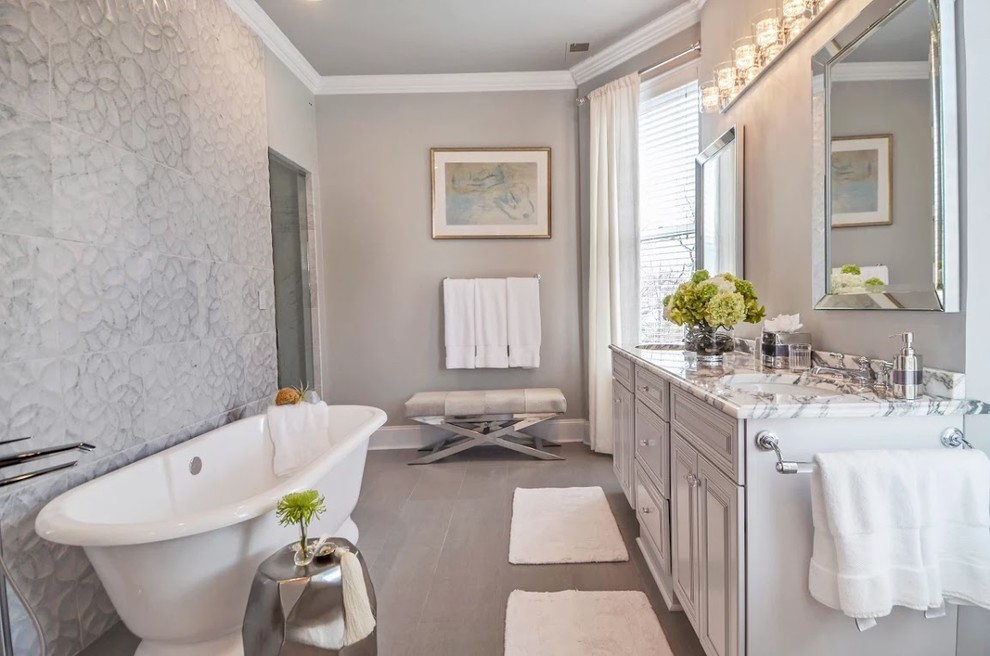 Inspiration for a mid-sized transitional master gray tile and cement tile porcelain tile and gray floor bathroom remodel in Chicago with raised-panel cabinets, gray walls, an undermount sink, marble countertops, a hinged shower door and gray cabinets
