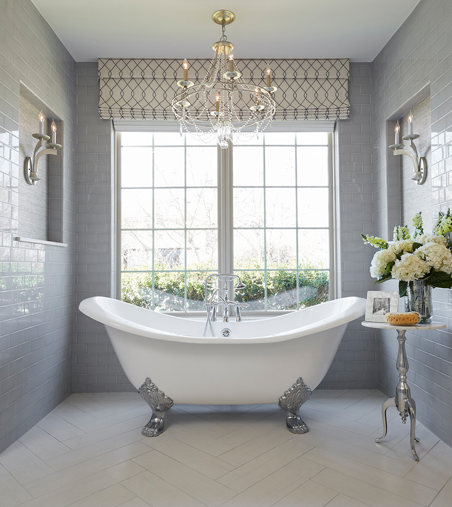 Claw-foot bathtub - traditional master gray tile and subway tile white floor claw-foot bathtub idea in Dallas with gray walls