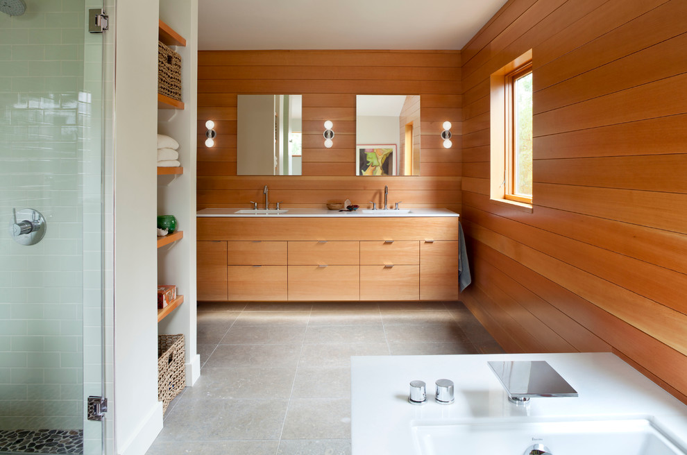 Bathroom - large modern master limestone floor and gray floor bathroom idea in Denver with an undermount sink, flat-panel cabinets, medium tone wood cabinets, marble countertops, brown walls and a hinged shower door