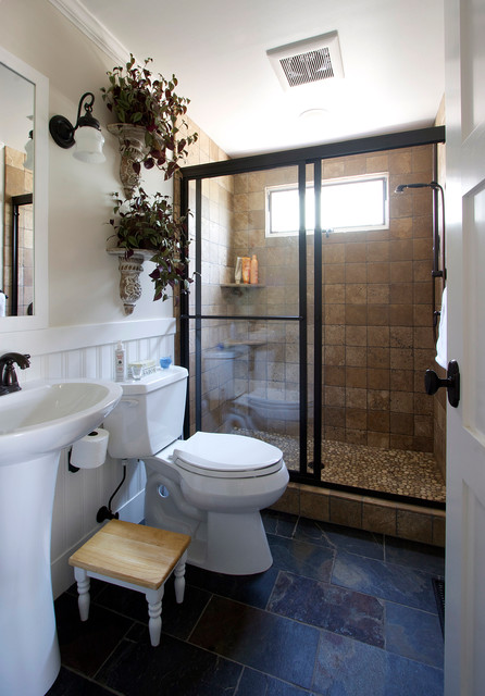 Example of a trendy brown tile bathroom design in London with a vessel sink