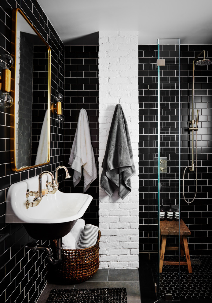 Example of a mid-sized cottage 3/4 black tile and subway tile porcelain tile and gray floor doorless shower design in New York with white walls and a wall-mount sink