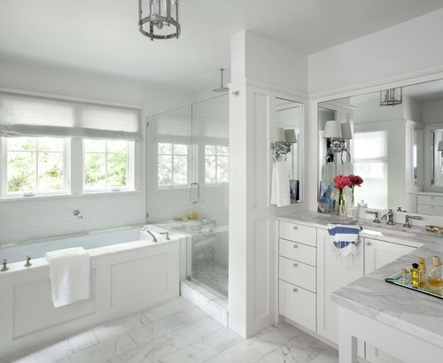 Packing the shower between the vanity and the soaking tub is a clever way to save space, especially when space is at a premium. Keeping the color palette light and bright helps keep the space feeling open and airy.