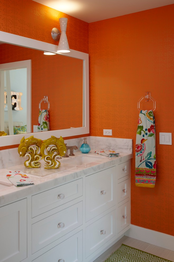 Bathroom - transitional bathroom idea in Orange County with white cabinets and orange walls