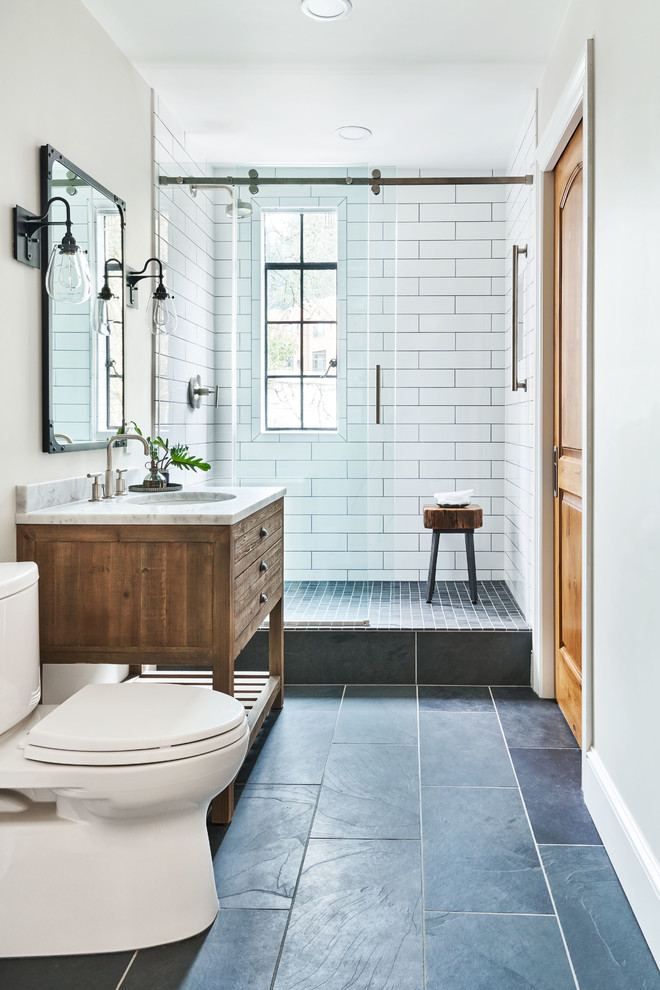 Example of a small transitional 3/4 white tile and ceramic tile bathroom design in Portland with furniture-like cabinets, distressed cabinets, a two-piece toilet, white walls, a console sink, marble countertops and gray countertops