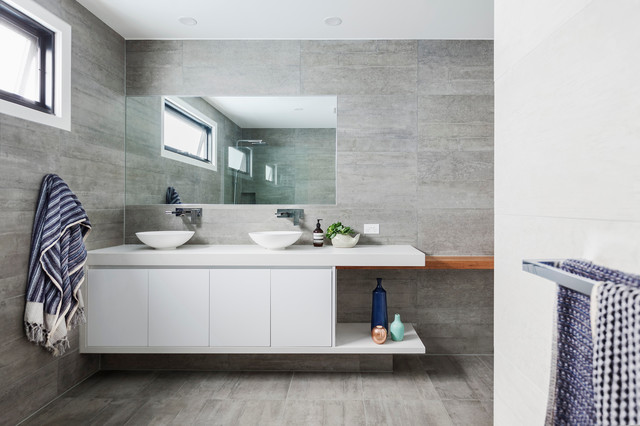 Inspiration for a mid-sized contemporary master concrete floor bathroom remodel in Melbourne with flat-panel cabinets, white cabinets, gray walls, a vessel sink and engineered quartz countertops