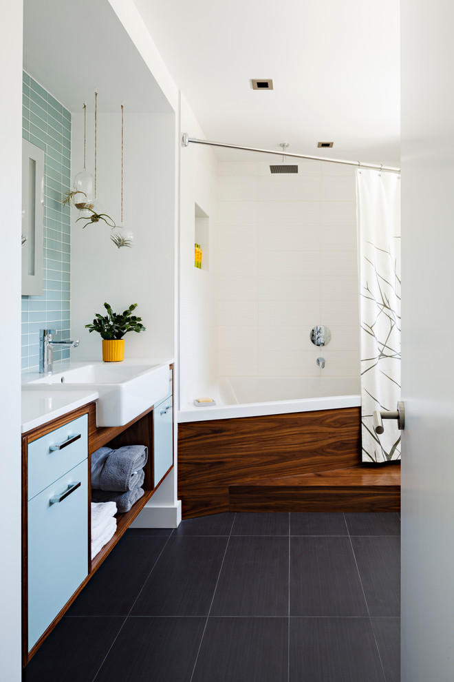 Inspiration for a contemporary blue tile black floor bathroom remodel in Seattle with a drop-in sink, flat-panel cabinets, blue cabinets and white countertops