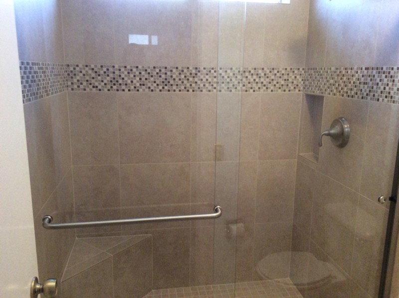 Example of a mid-sized classic beige tile and glass tile alcove shower design in Phoenix