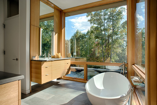 Extra windows bring natural light into your master bathroom.