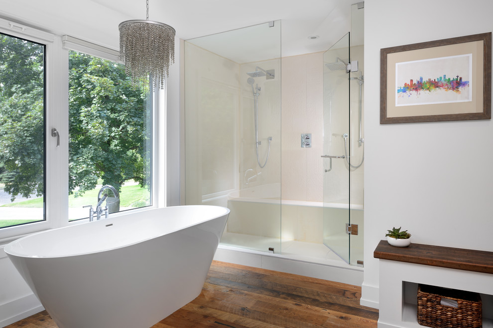Example of a trendy master beige tile medium tone wood floor bathroom design in Toronto with white walls, flat-panel cabinets, white cabinets and a hinged shower door